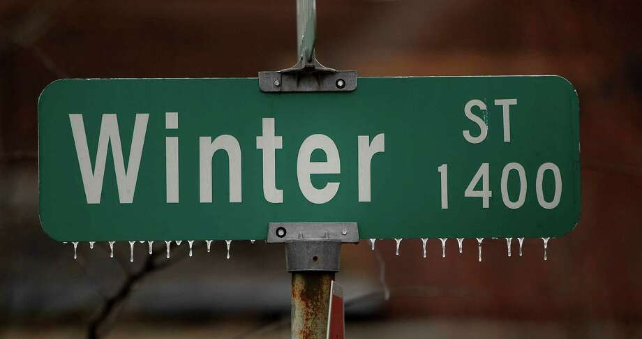 Icicles hang off of the Winter Street sign near downtown Houston on Tuesday. Photo: Karen Warren, Staff / © 2013 Houston Chronicle