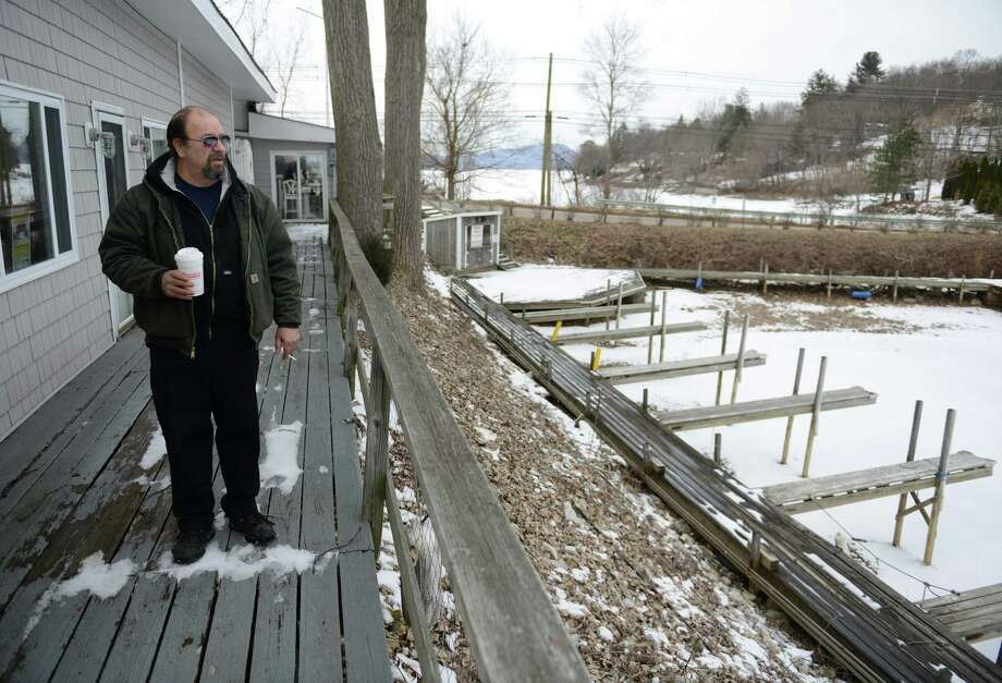 Owner George Manolis looks at the vacant boat slips at The Marina on Candlewood Lake in New Fairfield, Conn. Friday, Jan. 31, 2014.  Manolis is being forced to give up his boat slips after he was demanded to pay money because of a confusion in the lease. Photo: Tyler Sizemore / The News-Times