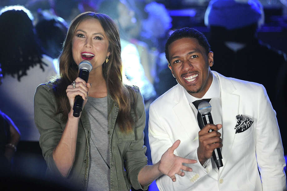 "Stacy Keibler (L) and Nick Cannon host VH1's ""Super Bowl Blitz: Six Nights + Six Concerts"" at Lehman College on January 28, 2014 in the Bronx borough of New York City. Photo: Gary Gershoff, WireImage / 2014 Gary Gershoff"