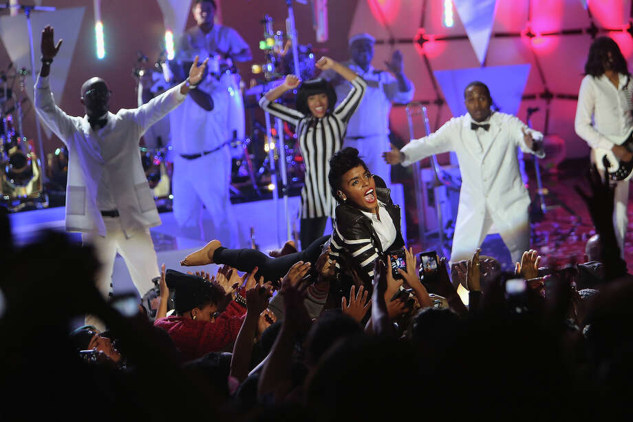 "Janelle Monae body surfs the crowd when she performs during VH1's ""Super Bowl Blitz: Six Nights + Six Concerts"" at Lehman College on January 28, 2014 in the Bronx borough of New York City. Photo: Al Pereira, Getty Images / 2014 Al Pereira"