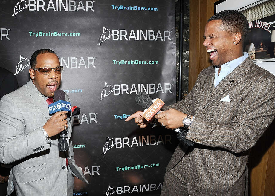 TV personalities Mike Bivins (L) and AJ Calloway attend Dr. Black's Brain Bar Super Bowl XLVIII Launch Event at PH-D Rooftop Lounge at Dream Downtown on January 30, 2014 in New York City. Photo: Gary Gershoff, WireImage / 2014 Gary Gershoff