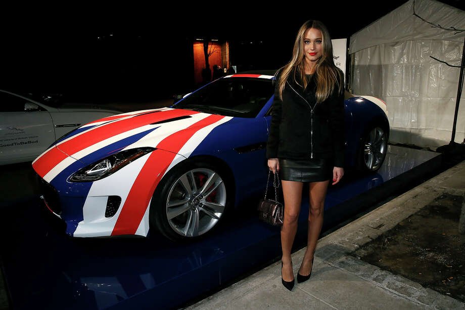 Model Hannah Davis poses with a 2014 Jaguar F-TYPE at the Sports Illustrated MVP Night with Lynn Swann and Jaguar at The Diageo Liquid Cellar on January 30, 2014 in New York City. Photo: Neilson Barnard, Getty Images For Jaguar / 2014 Getty Images