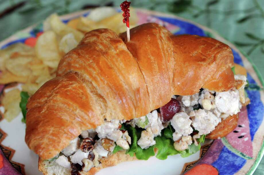 Chicken Waldorf has diced chicken breast, grapes, walnut, celery and mayo on a croissant and served with chips on Thursday, Jan. 23, 2014, at The Rustic Gourmet in Delmar, N.Y. (Cindy Schultz / Times Union) Photo: Cindy Schultz / 00025462A