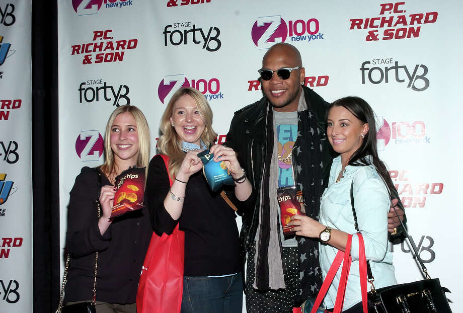 Flo Rida (2nd from R) attends the The P.C. Richard & Son Big Game Kick Off Party at Stage 48 on January 30, 2014 in New York City. Photo: Steven A Henry, Getty Images / 2014 Steven A Henry