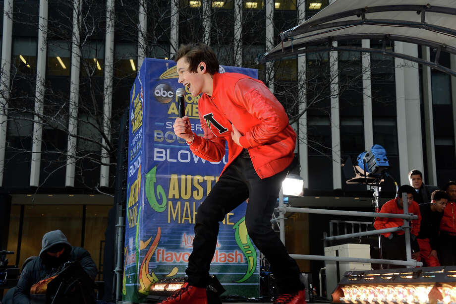 The Super Bowl Boulevard Blowout festivities continue all week on GOOD MORNING AMERICA, 1/31/14, airing on the ABC Television Network.  Austin Mahone performs live on the NFL stage on Broadway. Photo: Ida Mae Astute, ABC Via Getty Images / © 2014 American Broadcasting Companies, Inc. All rights reserved.