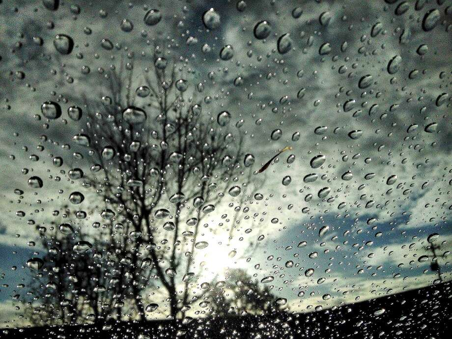 A drop in the bucket: Raindrops appear on a windshield following the first rain of the year in Novato, Calif. The light precipitation 