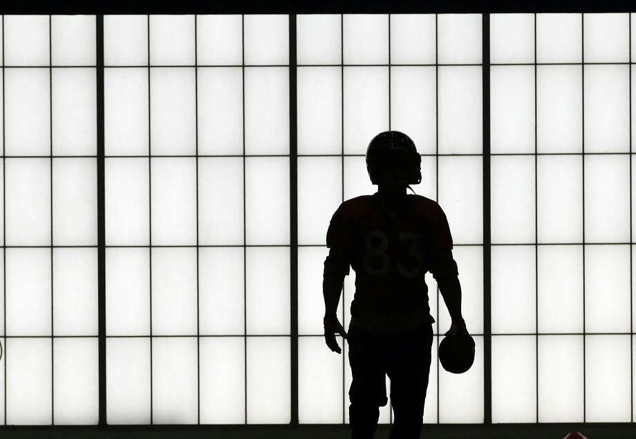 Super silhouette:An unidentified Bronco practices in the New York Jets' indoor facility in Florham Park, N.J. Photo: Associated Press