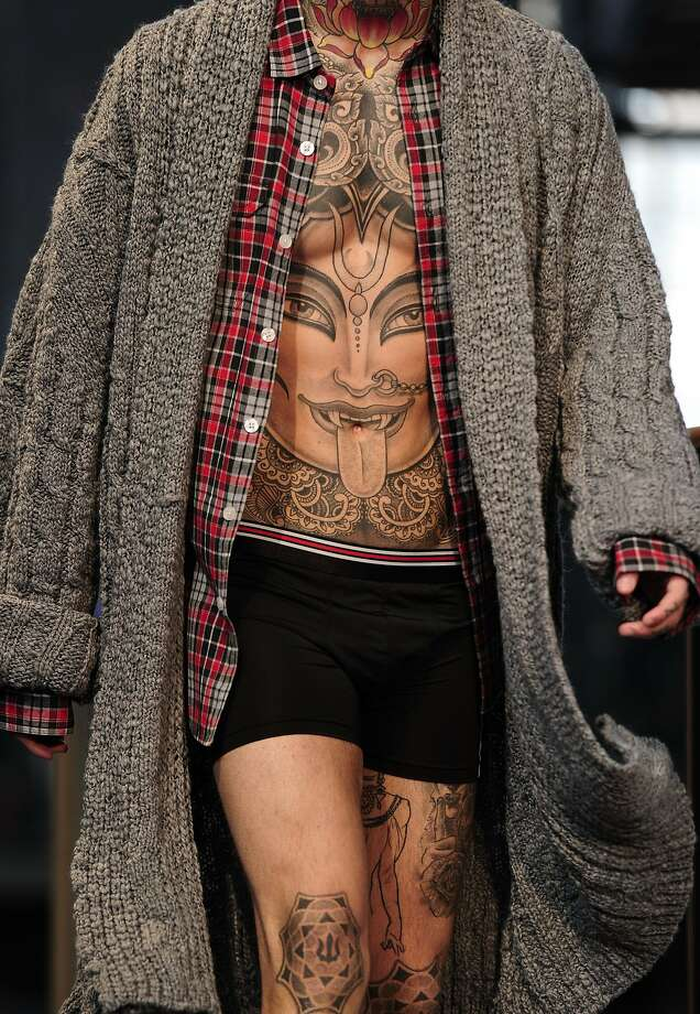 Naval decoration: A well-inked model presents a creation by Punto Blanco during the 080 Barcelona Autumn-Winter 2014-2015 Fashion Week. Photo: Josep Lago, AFP/Getty Images
