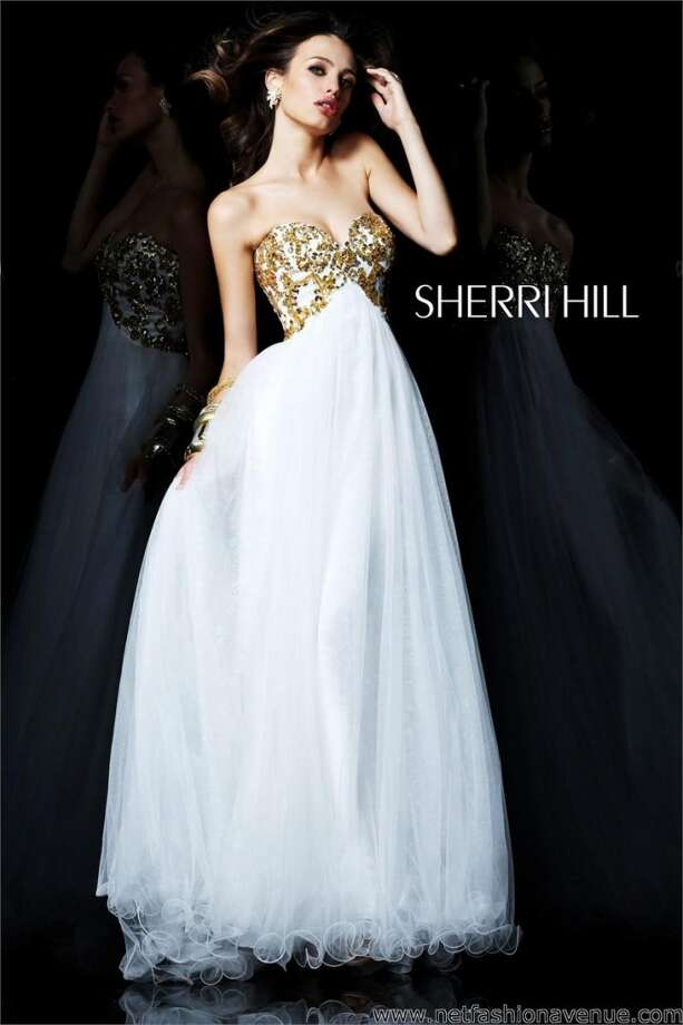 "If you don't want to go overboard, this Sherri Hill gown is perfect for you! The embellished gold top adds just the right amount of ""bling"" without going crazy."