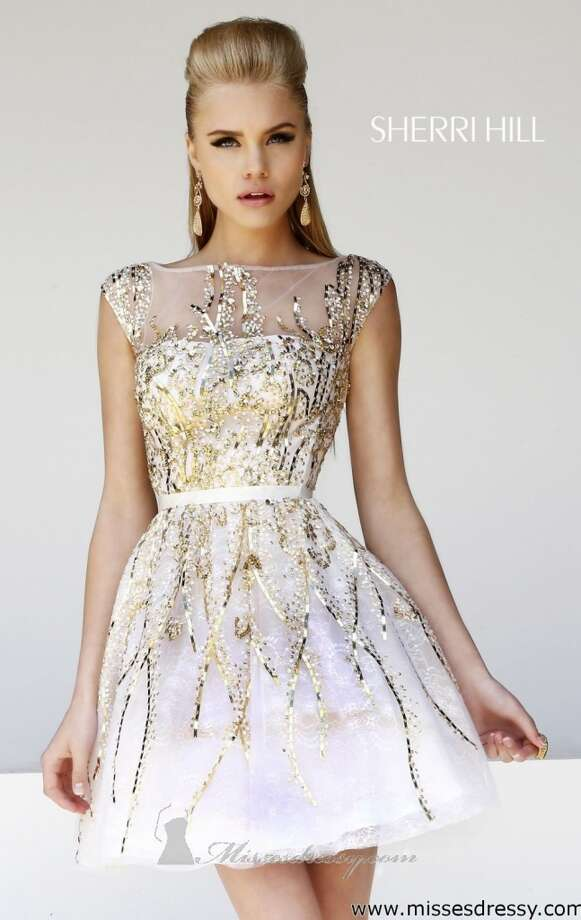 This short Sherri Hill dress provides the perfect amount of gold detailing!