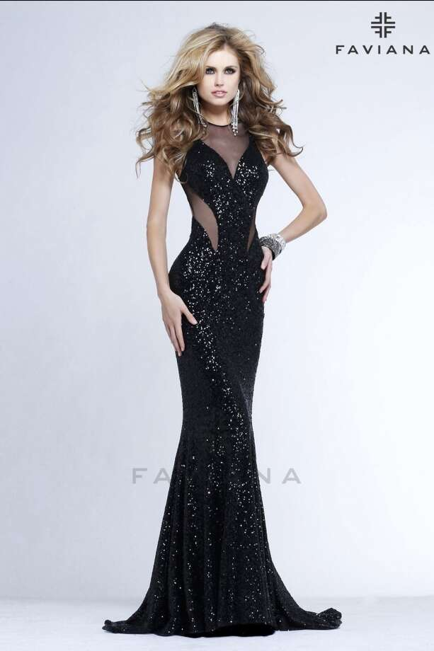 For $418 on PromGirl, this dress showcases some of this years biggest trends, cut outs and sequins!