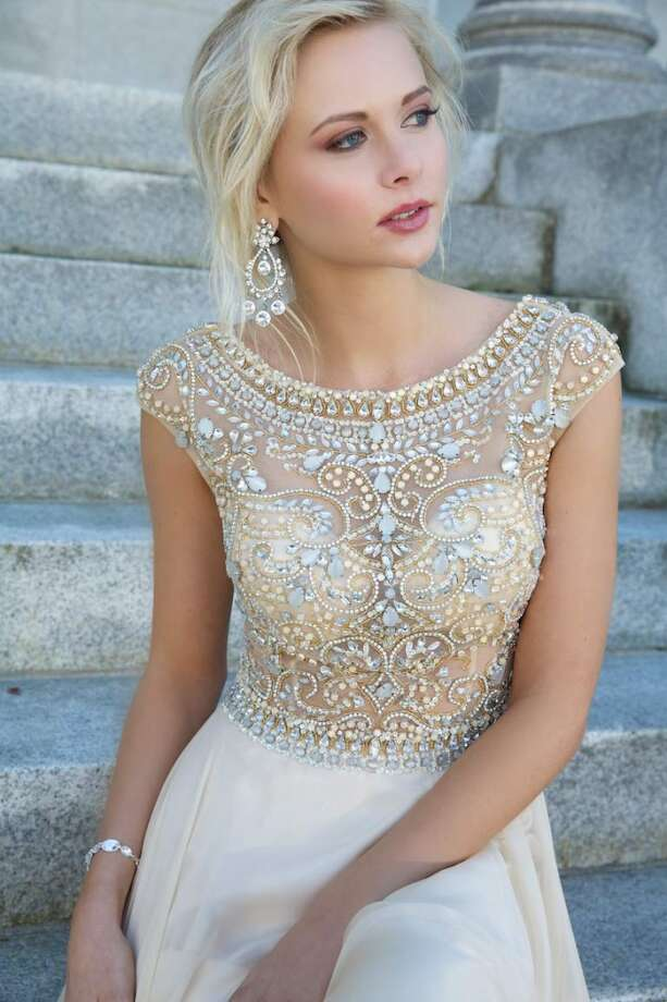 This Jovani gown is beautifully embellished and available in nude, a huge trend for the 2014 prom season.