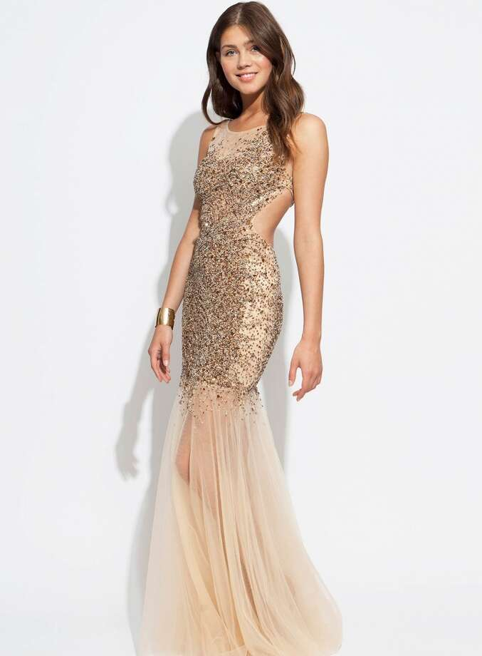 With a sheer bottom, sequin top and open back, this Jovani gown is perfect for any trendy prom goer.