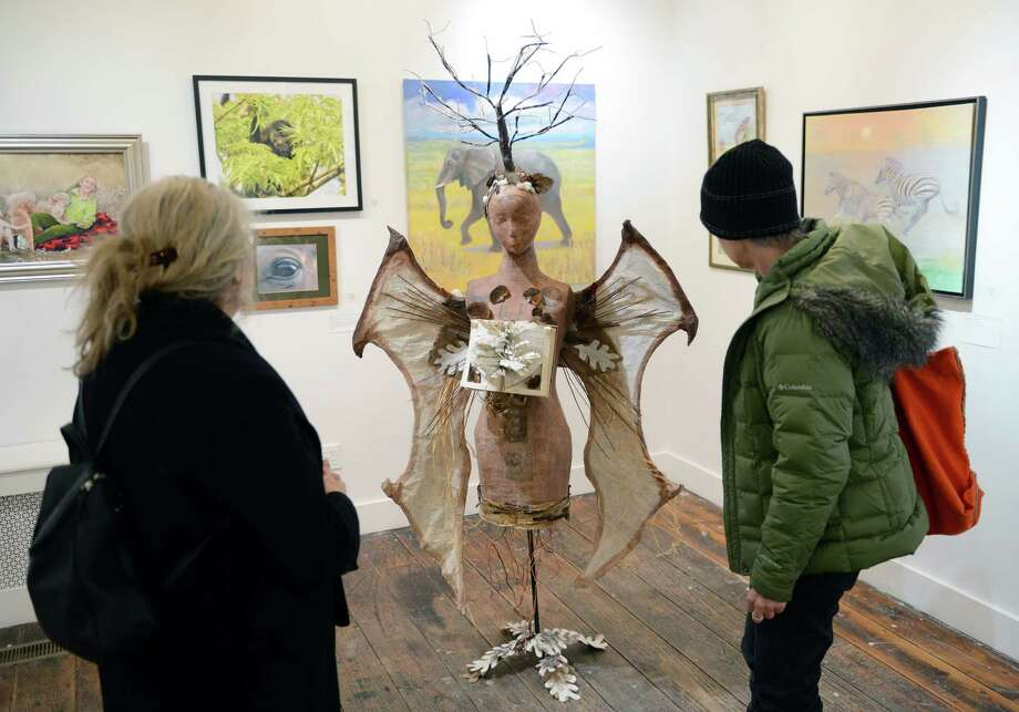 "Karen Weissman, left, of Redding, and Johanna Gotheil, of Ridgefield, look at _ as part of the ""Animal Spirit"" members show at the Ridgefield Guild of Artists gallery in Ridgefield, Conn. on Friday, Jan. 31, 2014.  The ""Animal Spirit"" exhibition displays both literal and abstract ideas in its work, depicting the spirit of animals in many forms and mediums.  The display runs through March 2 and the gallery is open from noon to 4 p.m. Wednesday through Sunday. Photo: Tyler Sizemore / The News-Times"