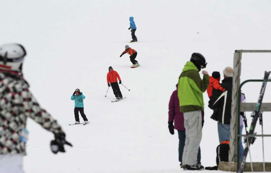 Skiers and snowboarders enjoy the milder weather at West Mountain Friday, Jan. 31, 2014 in Queensbury, N.Y.  (Lori Van Buren / Times Union) Photo: Lori Van Buren / 00025593A