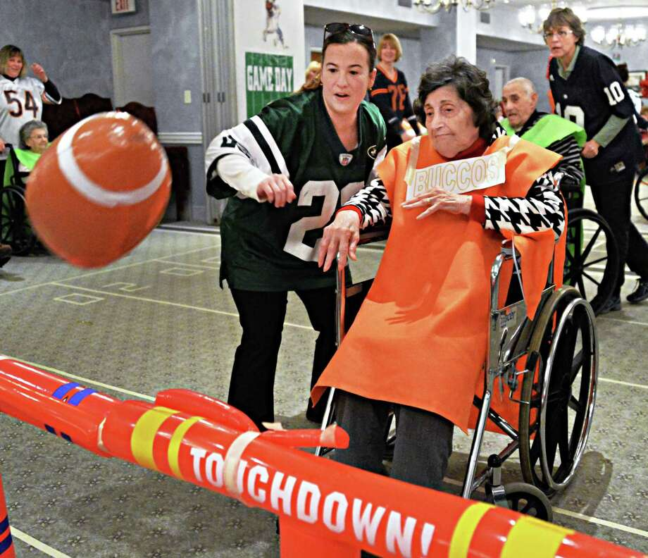 Denver Buccos' Anne Dominelli scores a touchdown with some help from Jennifer Goggin during Wheelchair Super Bowl XI Friday Jan. 31, 2014, at the Teresian House in Albany, N.Y.   (John Carl D'Annibale / Times Union) Photo: John Carl D'Annibale / 00025542A