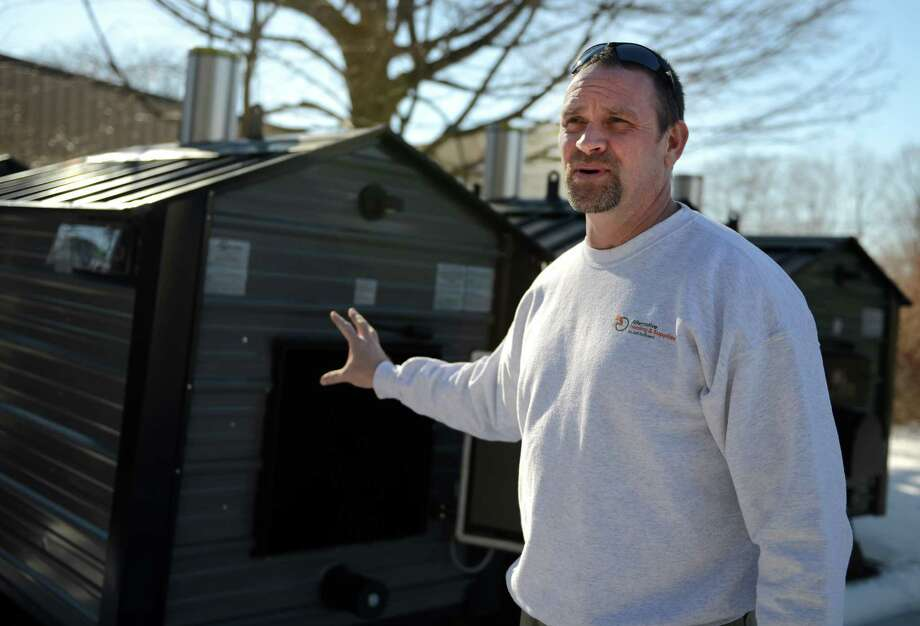 Jeff Luff talks about the new EPA regulations that will effect wood burning stoves like the ones he sells at his outdoor wood furnace shop, CT Wood Furnace in Oxford, Conn. Photo: Autumn Driscoll / Connecticut Post