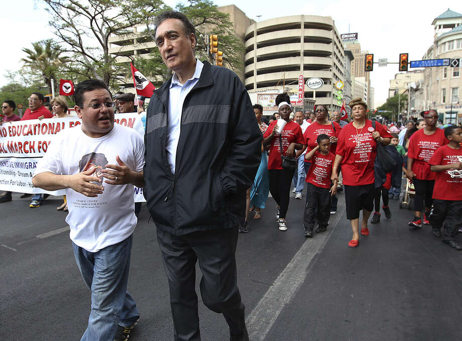 Former Mayor Henry Cisneros (right) walks in the César Chávez March for Justice through downtown last March. Photo: Kin Man Hui / San Antonio Express-News / © 2012 San Antonio Express-News