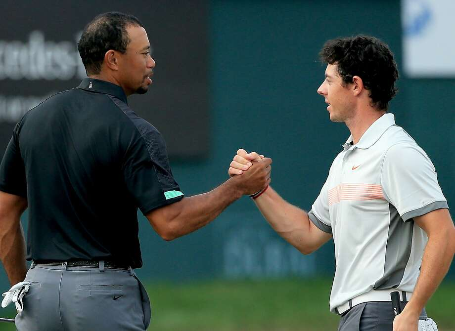 DUBAI, UNITED ARAB EMIRATES - JANUARY 31:  Rory McIlroy of Northern Ireland and Tiger Woods of the USA shake hands on the 18th greenduring the second round of the 2014 Omega Dubai Desert Classic on the Majlis Course at the Emirates Golf Club on January 31, 2014 in Dubai, United Arab Emirates. .  (Photo by Francois Nel/Getty Images) Photo: Francois Nel, Getty Images