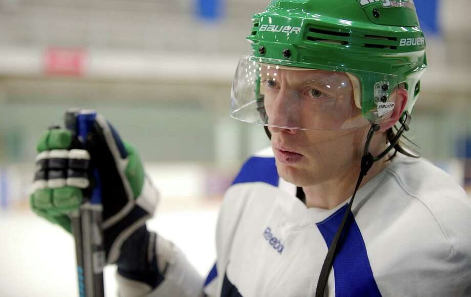 Danbury Whalers hockey player Ilya Solarev, 31, practices with the team in the Danbury, Conn, Ice Arena on Tuesday, January 28, 2014. Solarev is from Russia and has recently started playing for the Whalers. Photo: H John Voorhees III / The News-Times Freelance