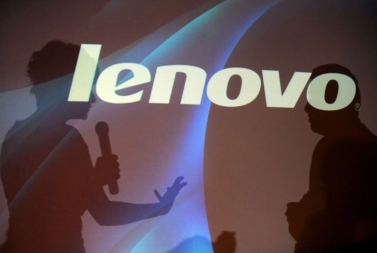 (FILES) The shadows of Bollywood actress Gul Panag (L) speaking with Lenovo India Managing Director Amar Babu on stage are seen at the unveiling of the new range of Lenovo products during a press conference in Bangalore in this June 23, 2010 file photo. Google announced on January 29, 2014 it signed a deal to sell its struggling smartphone unit Motorola to Chinese tech giant Lenovo for $2.91 billion.
