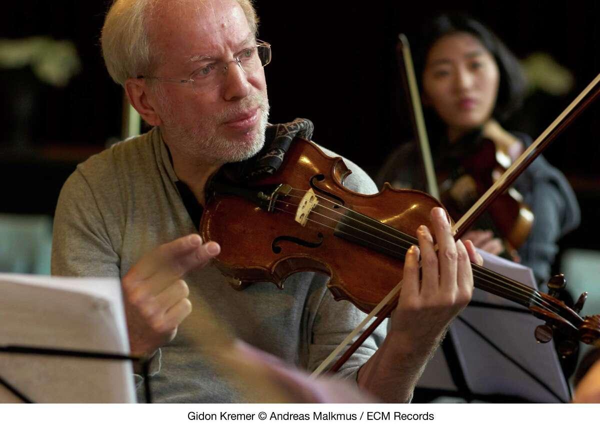 Violinist Gidon Kremer leads a rehearsal of his Kremerata Baltica chamber orchestra.