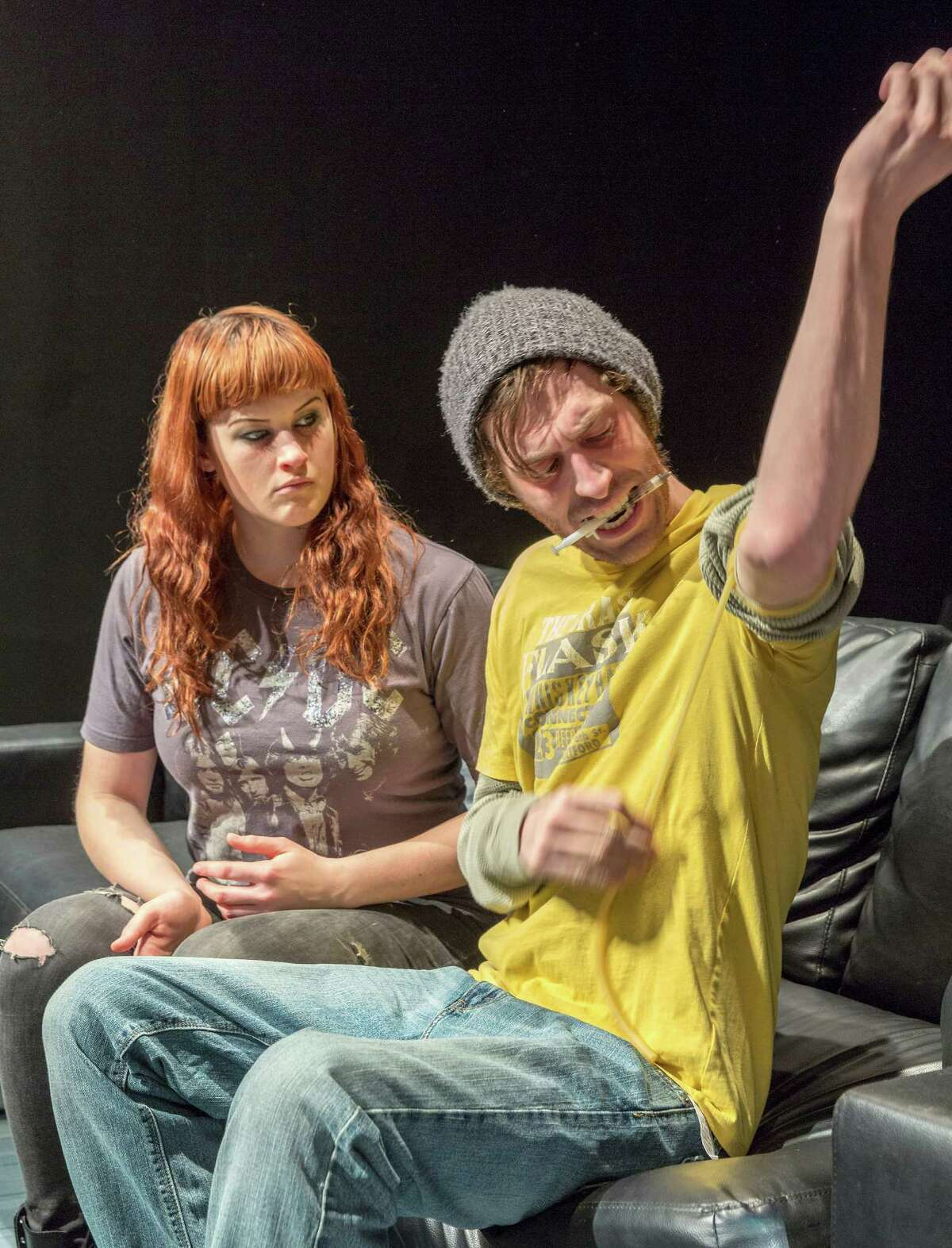 """Rachael (Jessica Janes) pushes Nick (John DeLoach) to quit shooting up in Catastrophic Theatre's world premiere of Miki Johnson's """"clean/through."""""""