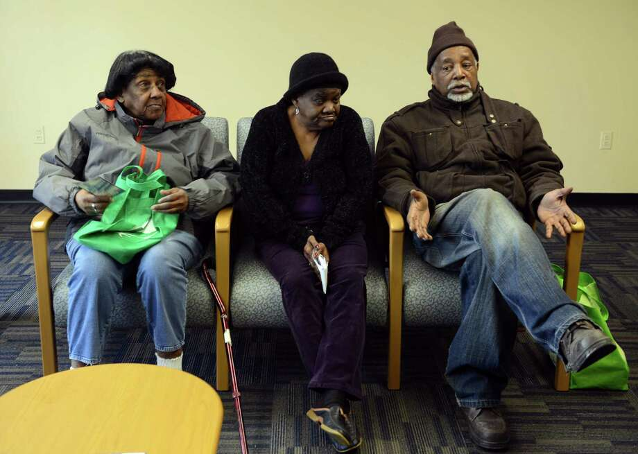 Tenants Louise Dent, Betty Ann Dickerson and Ralph Bolling, from left, talk about their lack of adequate heat in their apartments Friday, Jan. 31, 2014.  With the extreme cold the city of Bridgeport has been fielding numerous complaints from tenants like those at the Bridgeport Towers near CaptainâÄôs Cove Marina who say their landlordsâÄô are skimping on the heat or not making repairs. Photo: Autumn Driscoll / Connecticut Post