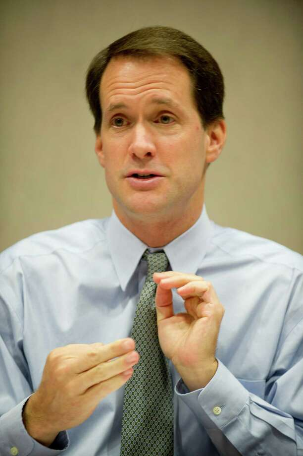 U.S. Rep. Jim Himes speaks to reporters at Landmark Square on Tuesday, Sept. 24, 2013, about fiscal matters facing Congress including the debt ceiling and the possibility of a government shut-down. Photo: Lindsay Perry / Stamford Advocate