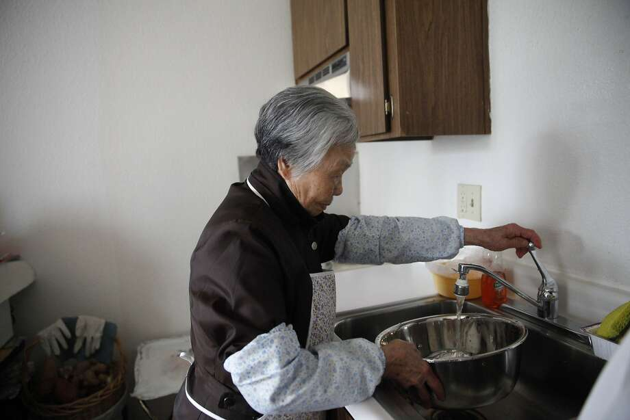 YWCA of San Francisco resident Wai Ying Pang, uses an aerator, installed by the SFPUC, while filling a bowl with water to clean vegetables on Tuesday, January 28, 2014 in San Francisco, Calif.  Pang was demonstrating how she puts water into a bowl, instead of letting the water run,  to clean vegetables which helps save water. Photo: Lea Suzuki, The Chronicle