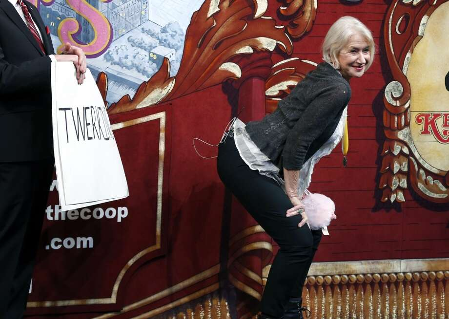 "Actress Helen Mirren ""twerks"" onstage during her roast as woman of the year by Harvard University's Hasty Pudding Theatricals in Cambridge, Mass., Thursday, Jan. 30, 2014. Photo: Elise Amendola, Associated Press"