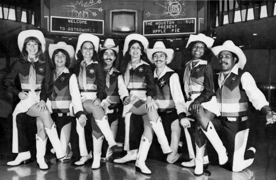 The Houston Astros fielded a singing-dancing cheerleading group in 1980 called Apple Pie. The group's eight performers, who wore Western-themed costumes in the Astros' bold colors of the period, posed in the Astroworld Hotel's Hofheinz Suite for this promotional photograph. Molly Glentzer, then 24, is at far left.  Photo courtesy Molly Glentzer. / handout