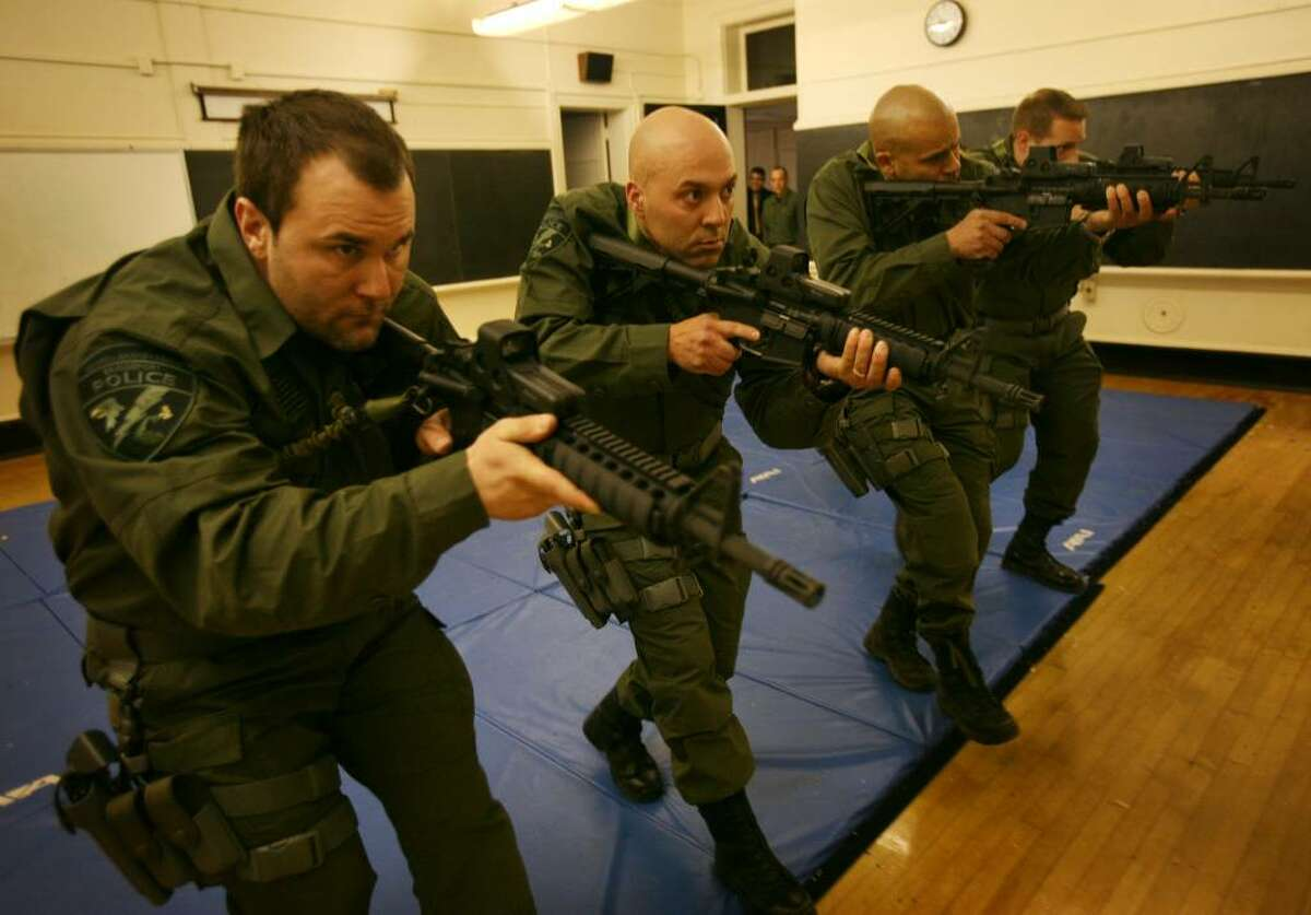 From left; Det. James Borrico, Off. Manny Santos, Off. Al Figueroa, Off. John Gale, and four other new members of Bridgeport's Emergency Services Unit, the city's version of a SWAT team, undergo training at the Bridgeport police academy on Newfield Avenue.