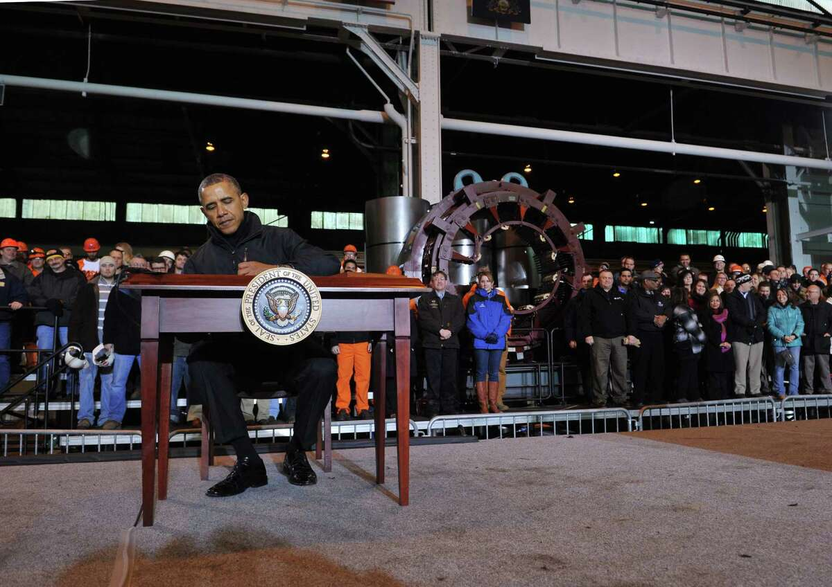 President Obama signs a memorandum during a visit to the U.S. Steel Irvin Plant in West Mifflin, Pa., at which he discussed a new proposal to help Americans save for retirement.