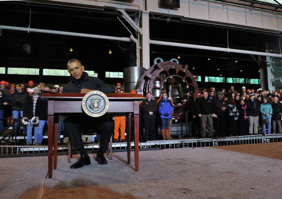 President Obama signs a memorandum during a visit to the U.S. Steel Irvin Plant in West Mifflin, Pa., at which he discussed a new proposal to help Americans save for retirement. Photo: MANDEL NGAN / AFP/Getty Images / AFP