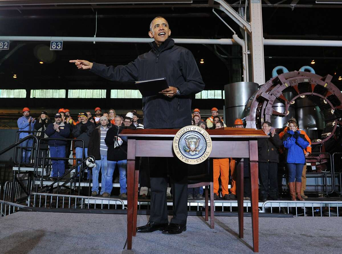 US President Barack Obama holds up a memorandam which he just signed after speaking at the US Steel Irvin Plant in West Mifflin, Pennsylvania on January 29, 2014. After delivering a State of the Union Address that focused on strengthening the struggling middle class, President Obama on Wednesday headed to Pennsylvania to discuss a new proposal, titled MyRA, to help Americans save for retirement. The administration, which says that half of all workers dont have access to employer-sponsored retirement plans, will allow Americans to invest a portion of their salary into government bonds in an account that will be treated like a Roth IRA -- a common type of retirement savings account. AFP PHOTO/Mandel NGANMANDEL NGAN/AFP/Getty Images