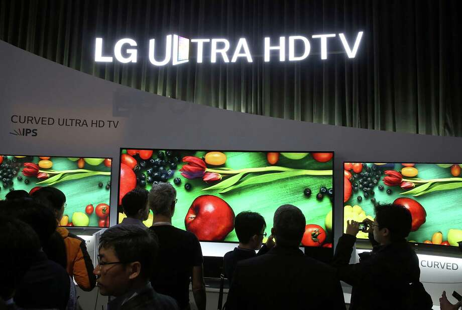 LAS VEGAS, NV - JANUARY 07:  Attendees look at a dsiplay of curved Ultra HDTV televisions at the LG booth at the 2014 International CES at the Las Vegas Convention Center on January 7, 2014 in Las Vegas, Nevada. CES, the world's largest annual consumer technology trade show, runs through January 10 and is expected to feature 3,200 exhibitors showing off their latest products and services to about 150,000 attendees. Photo: Justin Sullivan, Getty Images / 2014 Getty Images