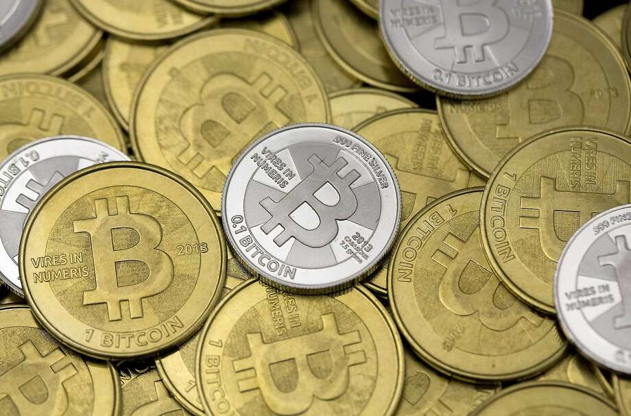 Bitcoin, a currency that exists in software code, can too easily be used by financial criminals, banking regulators around the world are saying. Photo: Jim Urquhart, Reuters