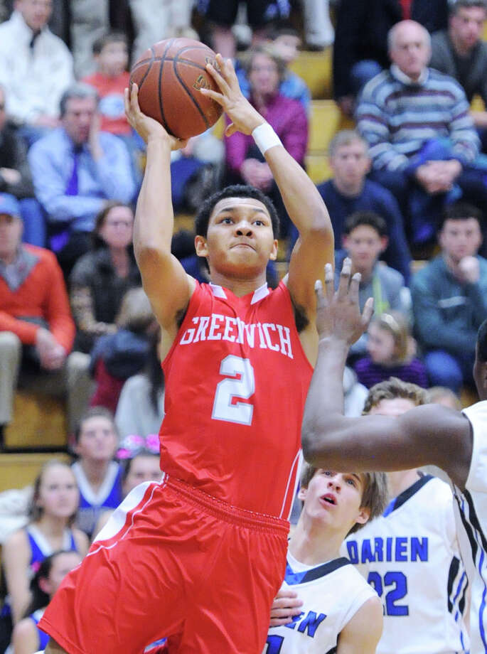 CJ Byrd (#2) of Greenwich scores on a layup during the high school basketball game between Darien High School and Greenwich High School at Darien, Friday night, Jan. 31, 2014. Photo: Bob Luckey / Greenwich Time