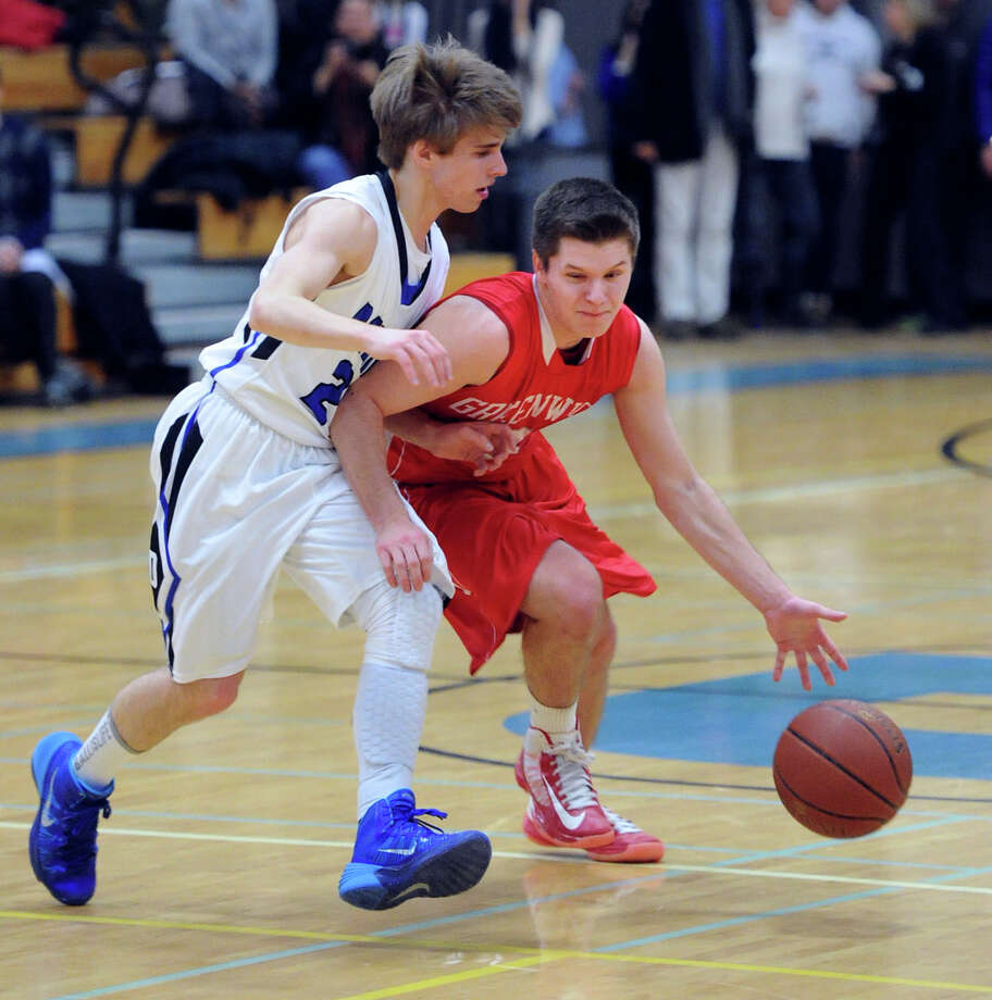 At right, Tommy Povinelli (#3) of Greenwich attempts to dribble around Matt Staubi (#21) of Darien during the high school basketball game between Darien High School and Greenwich High School at Darien, Friday night, Jan. 31, 2014. Photo: Bob Luckey / Greenwich Time