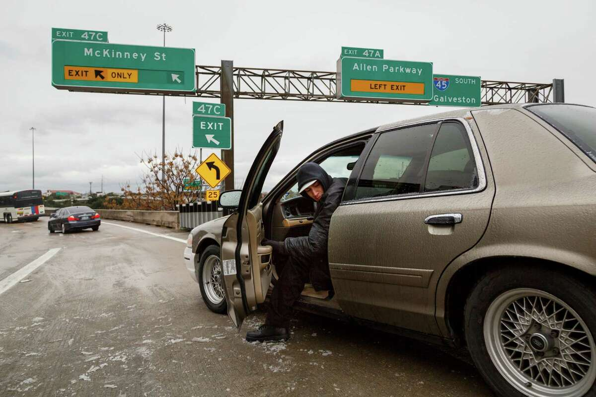 Riogo Rodriguez tries to back his car out after becoming stranded for over two hours on the McKinney St. exit ramp off of I-45 due to icy road conditions that snarled the morning commute, Friday, Jan. 24, 2014, in Houston. (AP Photo/Houston Chronicle, Michael Paulsen)