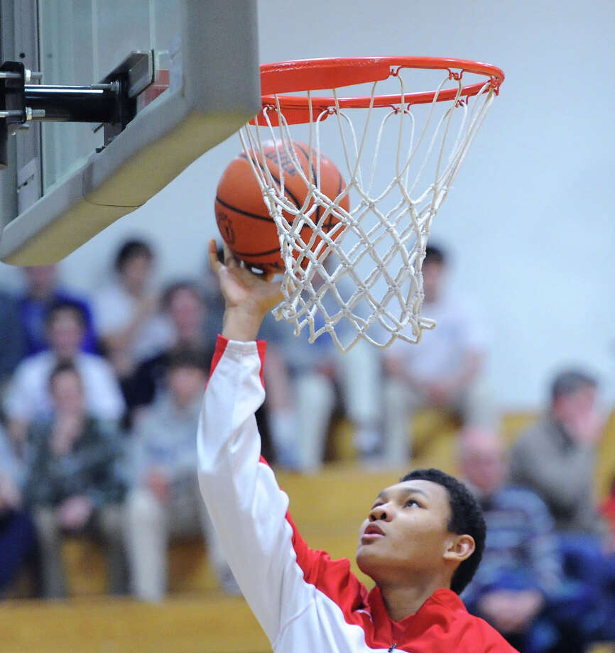 CJ Byrd of Greenwich during warm-ups prior to the start of the high school basketball game between Darien High School and Greenwich High School at Darien, Friday night, Jan. 31, 2014. Photo: Bob Luckey / Greenwich Time