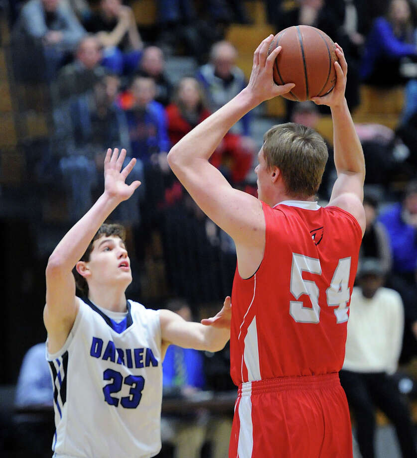 At left, Hudson Hamill (#23) of Darien defends against Alex Wolf (# 32) of Greenwich during the boys high school basketball game between Darien High School and Greenwich High School at Darien, Friday night, Jan. 31, 2014. Photo: Bob Luckey / Greenwich Time