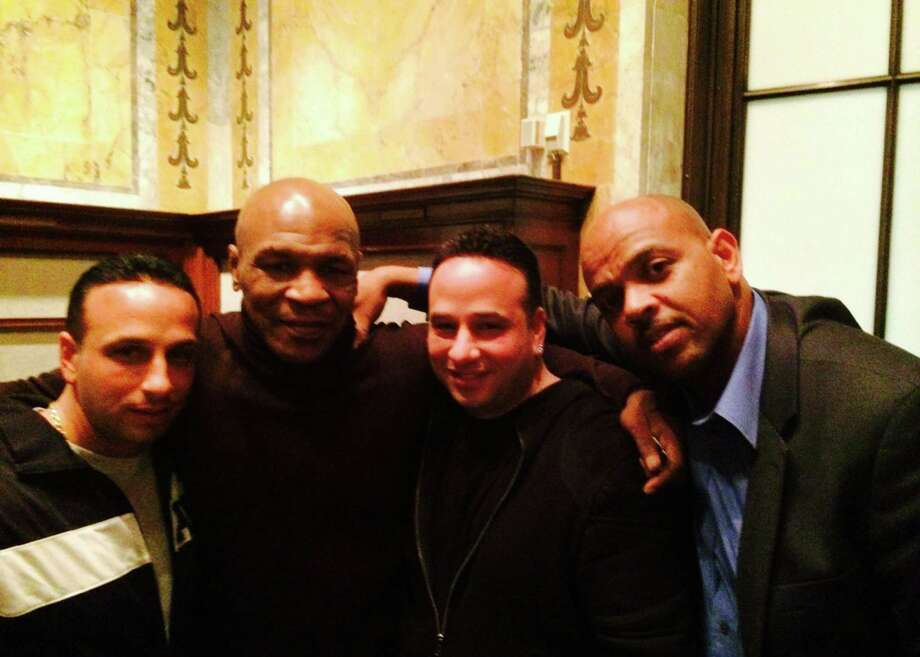 Stamford resident Al LoBalbo, heavyweight champion Mike Tyson, Stamford resident Sal LoBalbo and Tyson's childhood friend Dave Malone at Foxwoods Resort Casino last weekend Photo: Contributed Photo / Greenwich Citizen
