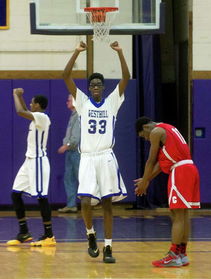 Westhill and Bridgeport Central players react when Central lost possesion of the ball with two seconds remaining during Friday's basketball game at Westhill High School on January 31, 2014. Photo: Lindsay Perry / Stamford Advocate