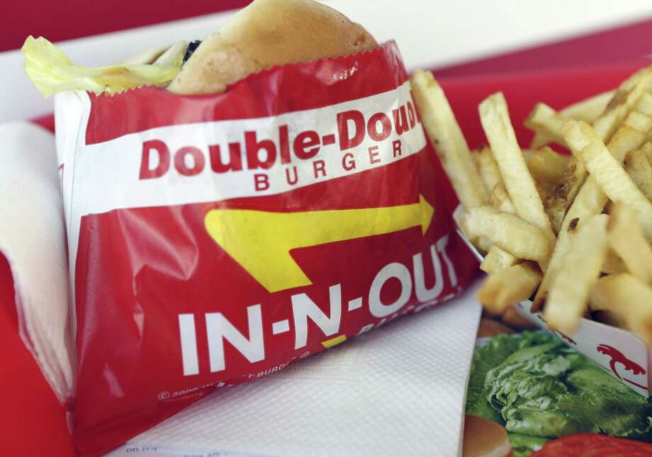 A Double-Double burger and french fries are In-N-Out Burger standards. Photo: Patrick Fallon / Bloomberg / © 2013 Bloomberg Finance LP