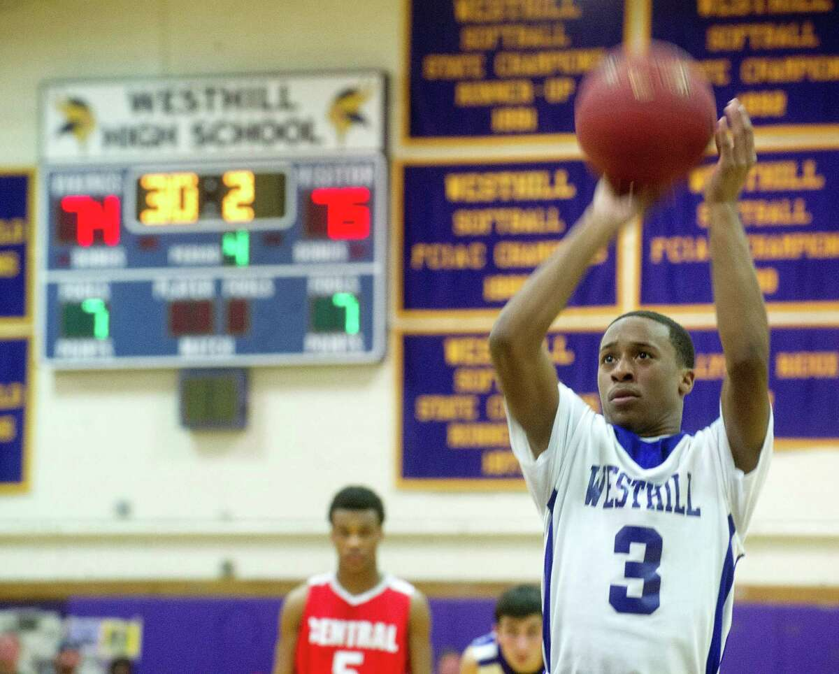 Westhill's CJ Donaldson makes a free-throw to tie the score with Bridgeport Central at 75 points during Friday's basketball game at Westhill High School on January 31, 2014.