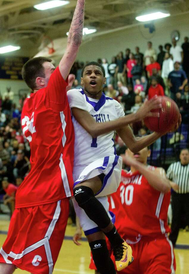 Westhill's Jeremiah Livingston puts up a shot against Bridgeport Central during Friday's basketball game at Westhill High School on January 31, 2014. Photo: Lindsay Perry / Stamford Advocate