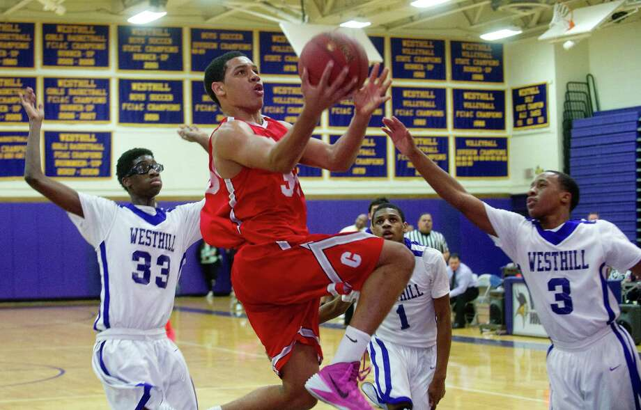 Bridgeport Central's Marcus Blackwell puts up a shot during Friday's basketball game at Westhill High School on January 31, 2014. Photo: Lindsay Perry / Stamford Advocate