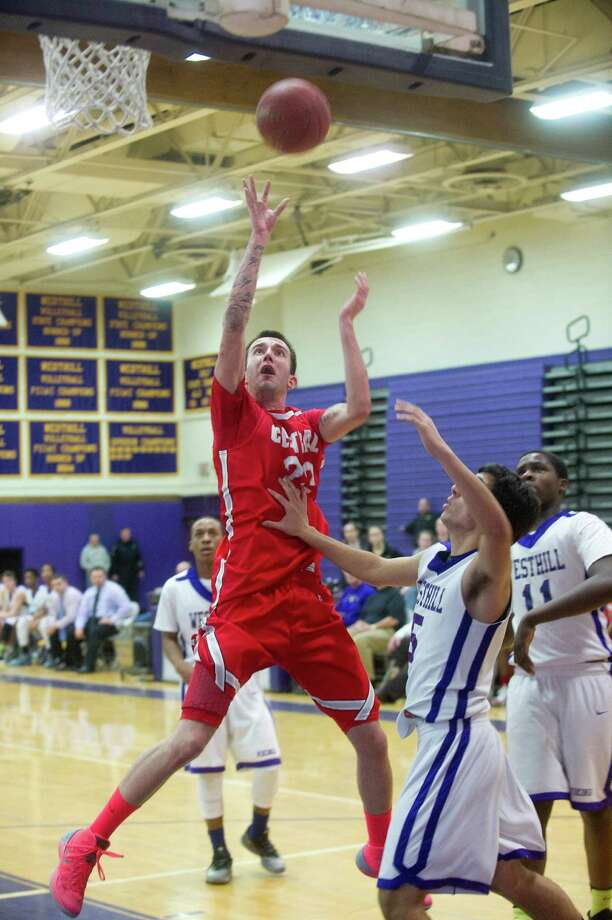 Bridgeport Central's Orhan Cecunjamin puts up a shot during Friday's basketball game at Westhill High School on January 31, 2014. Photo: Lindsay Perry / Stamford Advocate